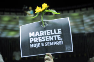 "Protest sign showing slogan ""Marielle, presente."""