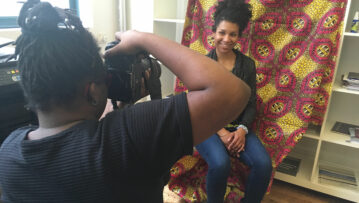 Photographer Kearra Amaya Gopee shoots artist Cicely Carew in the Black Lunch Table x Art+Feminism edit-a-thon at Triangle Art Association